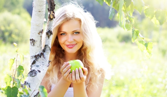 Beautiful girl holding an apple
